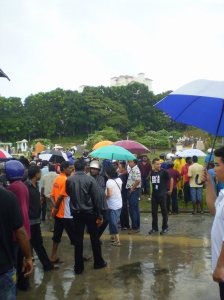 The heavy downpour that came with the dark clouds did not deter the crowd from giving Kugan a dignified send off.